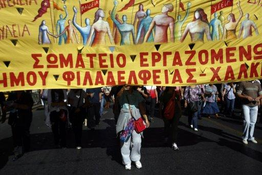 <p>Demonstrators march in front of the Greek parliament in central Athens during protests against new austerity measures and a rally marking a 48-hour general strike, on November 6. Greek lawmakers vote Wednesday on austerity measures needed to unlock international aid and stave off bankruptcy despite strikes and public anger against billions more euros in tax hikes and pension cuts.</p>