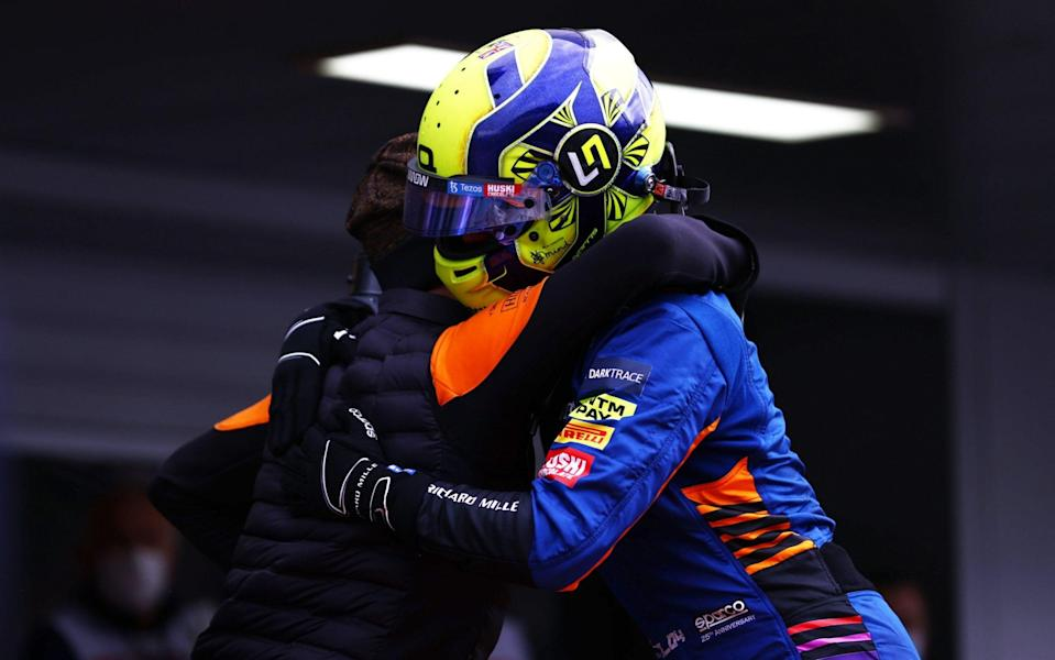 Pole position qualifier Lando Norris of Great Britain and McLaren F1 celebrates in parc ferme during qualifying ahead of the F1 Grand Prix of Russia at Sochi Autodrom on September 25, 2021 in Sochi, Russia - Mark Thompson/Getty Images