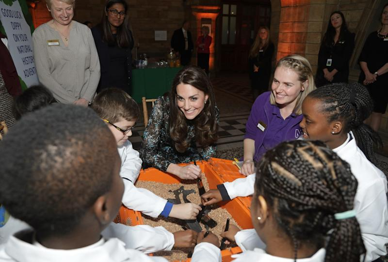 Kate Middleton talks to schoolchildren at the event. (Photo: Getty Images)