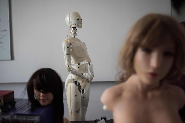 Robots in a lab of a doll factory of EX Doll, a firm based in Dalian, China, Feb. 1, 2018. (Photo: Fred Dufour/AFP/Getty Images)
