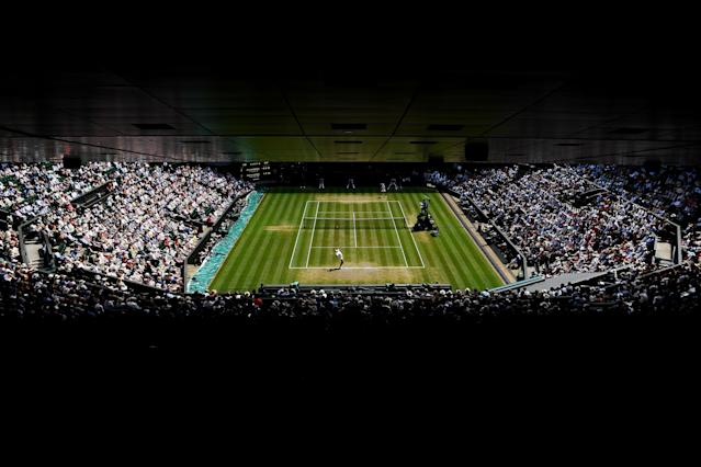 "The Wimbledon semifinal match between <a class=""link rapid-noclick-resp"" href=""/olympics/rio-2016/a/1195086/"" data-ylk=""slk:Rafael Nadal"">Rafael Nadal</a> and <a class=""link rapid-noclick-resp"" href=""/olympics/rio-2016/a/1156004/"" data-ylk=""slk:Novak Djokovic"">Novak Djokovic</a> was suspended after three sets on Friday night. Play will resume on Saturday morning. (Getty Images)"
