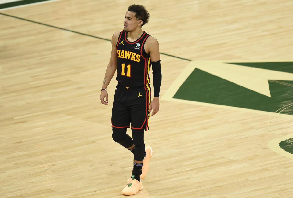 Trae Young #11 of the Atlanta Hawks looks on against the Milwaukee Bucks during the first half in game two of the Eastern Conference Finals at Fiserv Forum on June 25, 2021 in Milwaukee, Wisconsin. NOTE TO USER: User expressly acknowledges and agrees that, by downloading and or using this photograph, User is consenting to the terms and conditions of the Getty Images License Agreement. (Photo by Patrick McDermott/Getty Images)