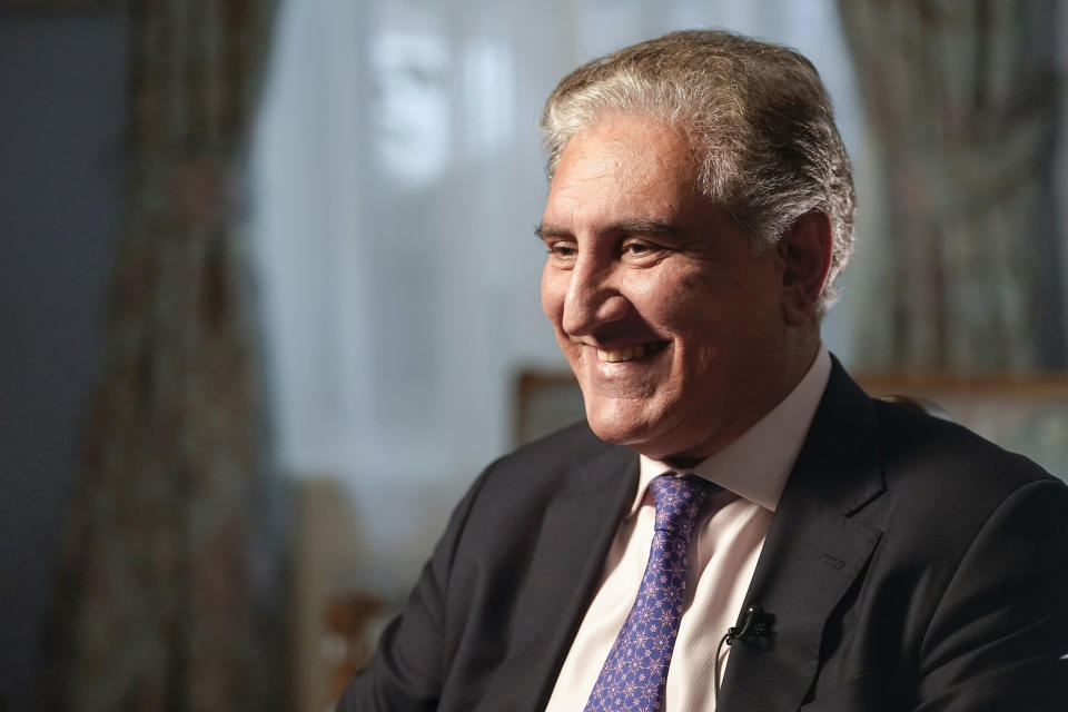 Pakistan's Foreign Minister Shah Mehmood Qureshi smiles during an interview with The Associated Press, Wednesday, Sept. 22, 2021, in New York. (AP Photo/Mary Altaffer)