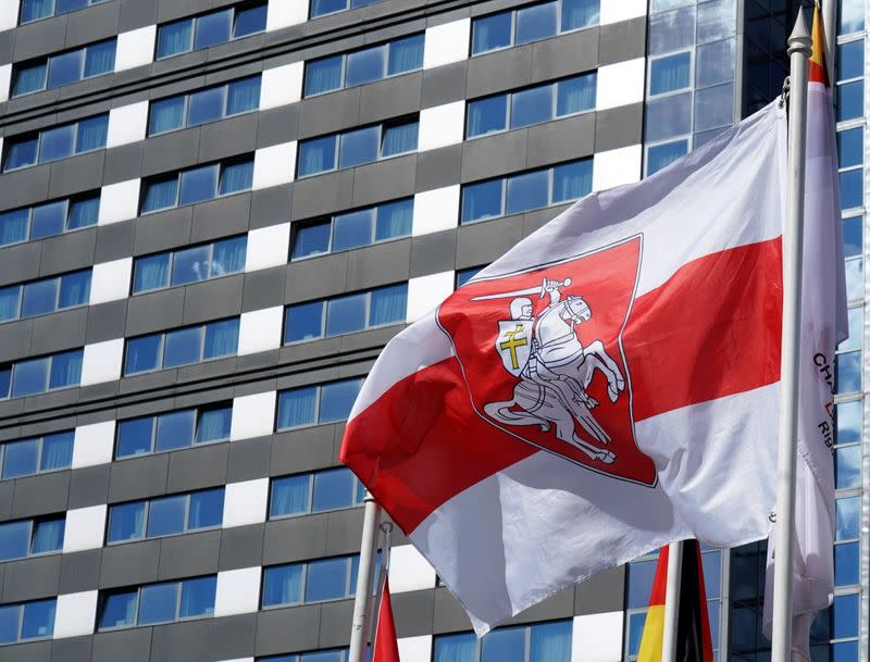 FILE PHOTO: Historical white-red-white flag of Belarus flies in Riga