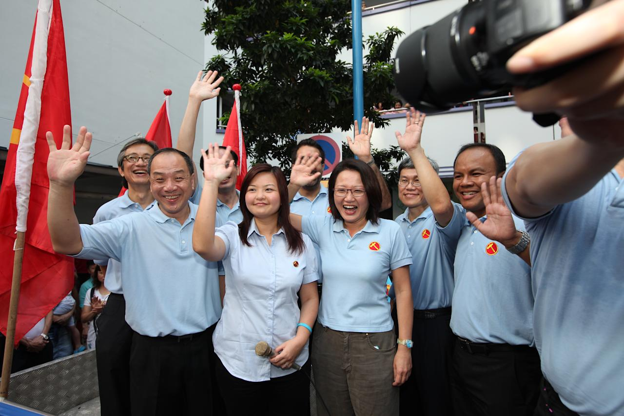 Workers Party's Lee Li Lian flanked by chief Low Thia Khiang and Sylvia Lim.
