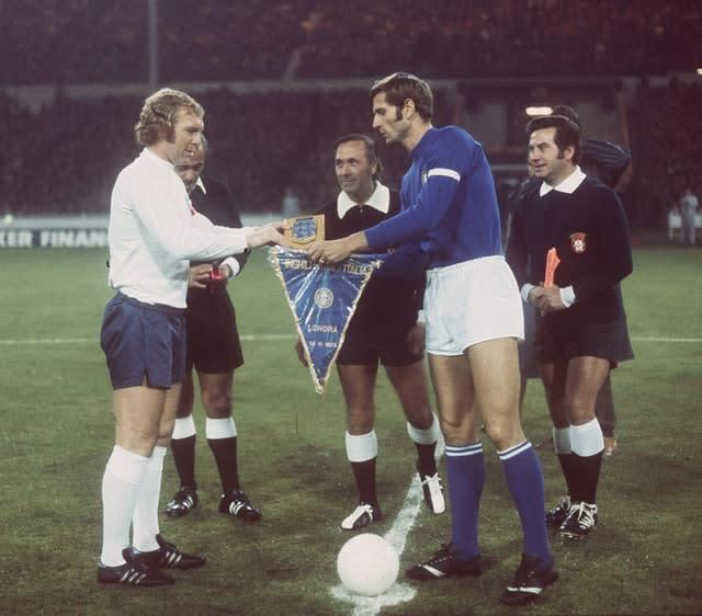 Bobby Moore, left, before kick-off in his final match for England (PA)