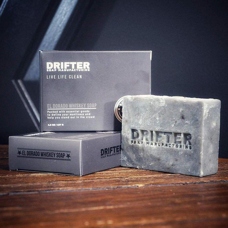"""<p><strong>DRIFTER</strong></p><p>amazon.com</p><p><strong>$14.00</strong></p><p><a href=""""https://www.amazon.com/dp/B07BQPJL3B?tag=syn-yahoo-20&ascsubtag=%5Bartid%7C2089.g.3171%5Bsrc%7Cyahoo-us"""" rel=""""nofollow noopener"""" target=""""_blank"""" data-ylk=""""slk:Shop Now"""" class=""""link rapid-noclick-resp"""">Shop Now</a></p><p>Infused with real <a href=""""https://www.thewhiskyexchange.com/p/18461/few-bourbon-whiskey"""" rel=""""nofollow noopener"""" target=""""_blank"""" data-ylk=""""slk:Few Spirits barrel-aged bourbon"""" class=""""link rapid-noclick-resp"""">Few Spirits barrel-aged bourbon</a>, this El Dorado Whiskey Soap from men's natural grooming brand DRIFTER will make you feel squeaky clean <em>and</em> dirty all at the same time. With its heady scent of sandalwood, fir needle, and lemongrass, we think this soap makes a super unique gift for any whiskey lover.</p>"""