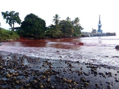 Waste from a nickel plant in Papua New Guinea owned by Metallurgical Corporation of China is seen in the waters of the adjacent Basamuk Bay