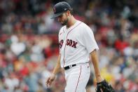 Boston Red Sox's Kutter Crawford walks off the field after being relieved during the third inning of a baseball game against the Cleveland Indians, Sunday, Sept. 5, 2021, in Boston. (AP Photo/Michael Dwyer)