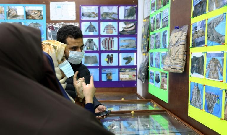 Libyans, shown in January, checking for news of loved ones check belongings of people found in mass graves around Tarhuna, at the forensic medicine department in Tripoli Medical Center
