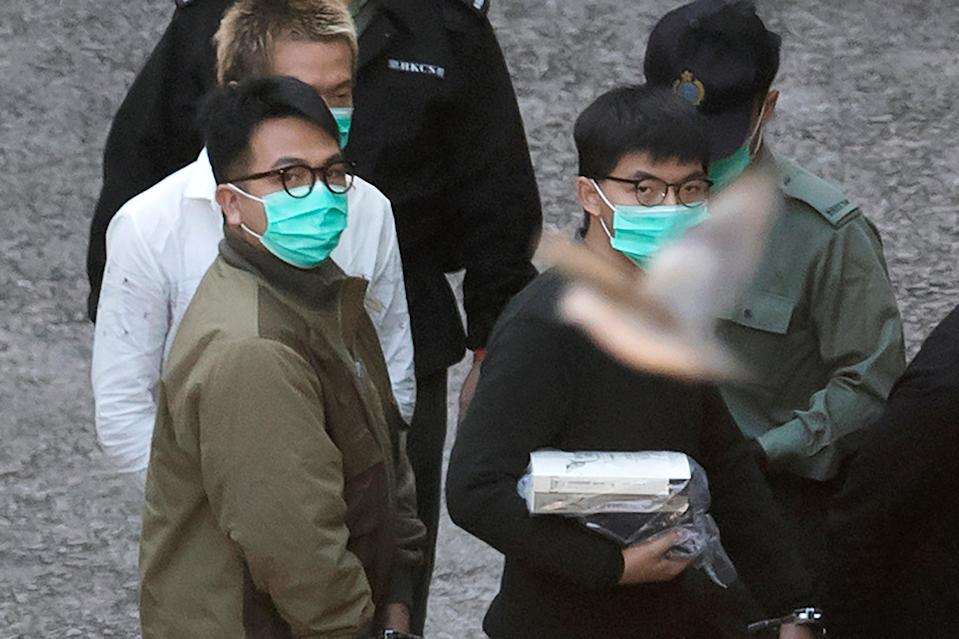 <p>Hong Kong pro-democracy activists Joshua Wong, Agnes Chow and Ivan Lam were handed prison sentences on Wednesday</p> (AP)
