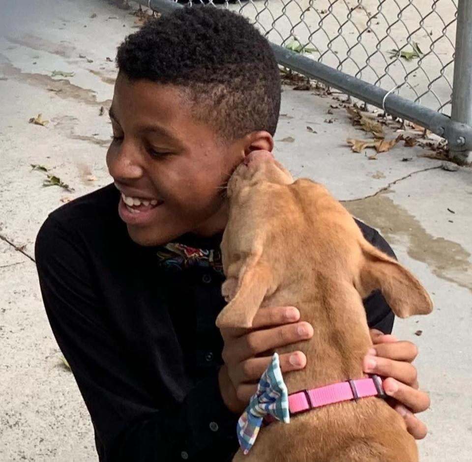Darius Brown with a dog