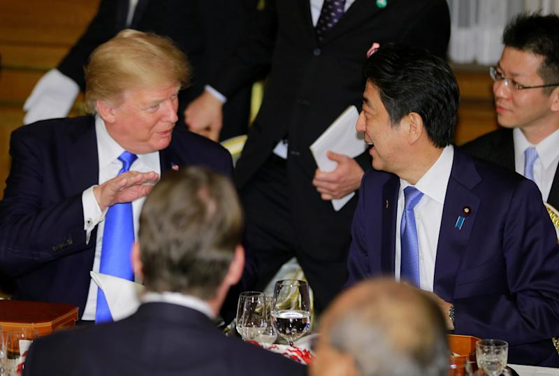 U.S. President Donald Trump talks with Japanese Prime Minister Shinzo Abe at a welcome dinner at Tokyo's Akasaka Palace on Nov. 6, 2017. (REUTERS/Shizuo Kambayashi/Pool)