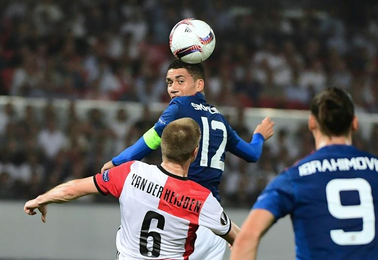 Manchester United's Chris Smalling heads the ball during their UEFA Europa League Group A match against Feyenoord Rotterdam, at the Feyenoord Stadium in Rotterdam, on September 15, 2016