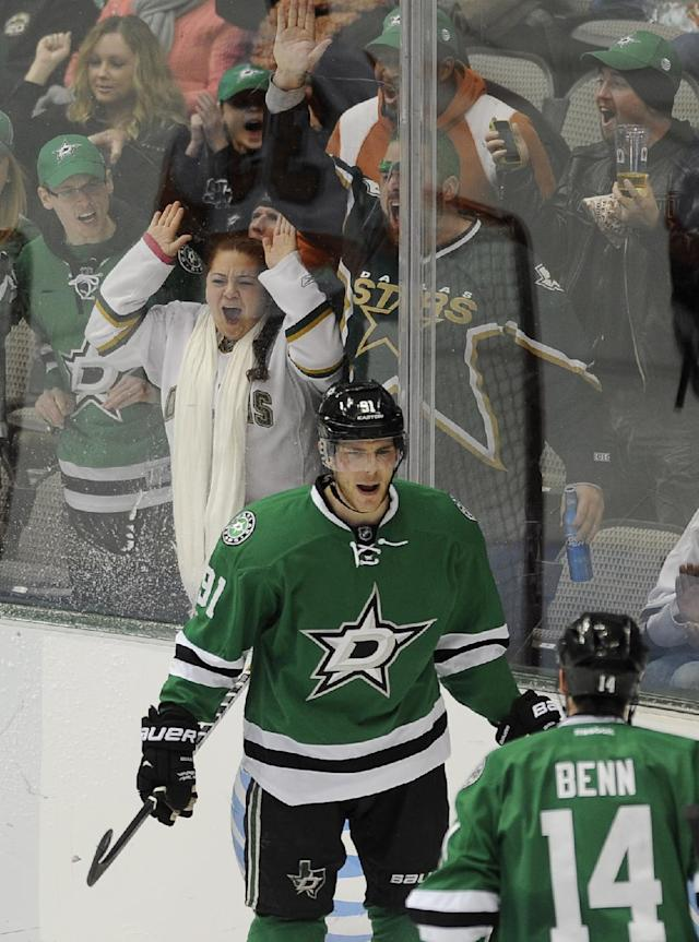 Dallas Stars center Tyler Seguin (91) celebrates with left wing Jamie Benn (14) Seguin's first goal in the second period during an NHL hockey game against the Philadelphia Flyers, Saturday, Dec. 7, 2013 in Dallas. (AP Photo/Matt Strasen)