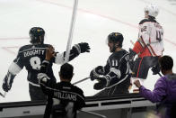 Los Angeles Kings center Anze Kopitar (11) celebrates his goal with Drew Doughty (8) during the second period of an NHL hockey game against the Anaheim Ducks on Tuesday, April 20, 2021, in Los Angeles. (AP Photo/Marcio Jose Sanchez)