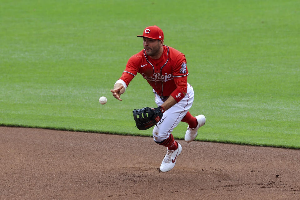Cincinnati Reds' Joey Votto fields the ball and throws to first base during the first inning of a baseball game against the Chicago White Sox in Cincinnati, Wednesday, May 5, 2021. (AP Photo/Aaron Doster)