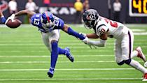 <p>Houston Texans defensive back Justin Reid (20) grabs the arm of New York Giants wide receiver Odell Beckham Jr. (13) during the first half of an NFL football game Sunday, Sept. 23, 2018, in Houston. (AP Photo/Eric Christian Smith) </p>