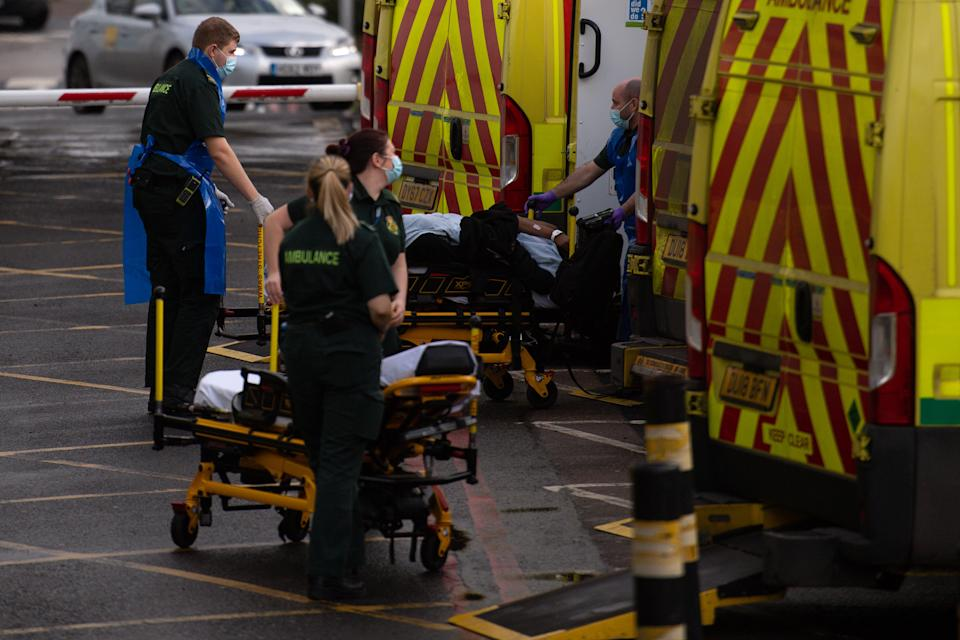 Ambulance crews transport patients into City Hospital in Birmingham. The West Midlands has several areas in the top 10 highest-growing coronavirus numbers.