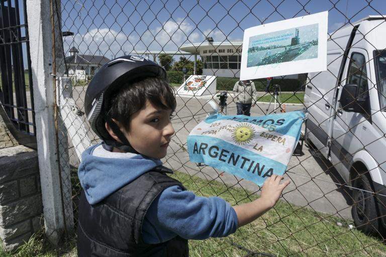 Banners and Argentine flags with message in support of submarine crew members are displayed outside Argentina's Navy base in Mar del Plata, on the Atlantic coast south of Buenos Aires