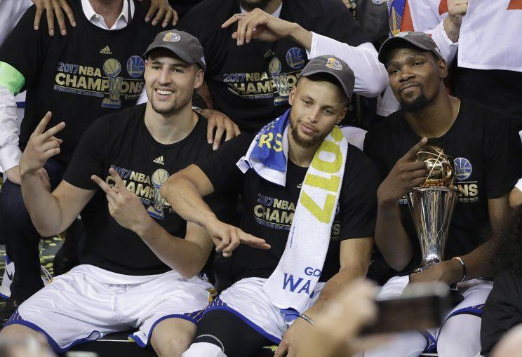 Klay Thompson, Stephen Curry and Finals MVP Kevin Durant celebrate their championship. (AP)