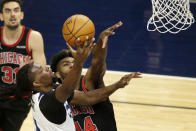 Minnesota Timberwolves center Naz Reid, left, shoots on Chicago Bulls forward Patrick Williams, right, in the second quarter during an NBA basketball game, Sunday, April 11, 2021, in Minneapolis. (AP Photo/Andy Clayton-King)