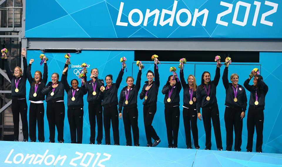 Gold medallists the United States celebrate on the podium during the medal ceremony for the Women's Water Polo on Day 13 of the London 2012 Olympic Games at the Water Polo Arena on August 9, 2012 in London, England. (Getty Images)