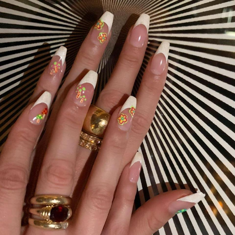 For her 24th birthday, Bella Hadid opted for these cute '70s flowers complete with magic mushrooms. The day-glo colors and square French tips took the look to the next level.