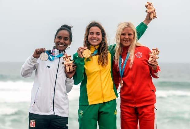Olin, right, on the podium at the 2019 Pan Am Games in Lima.
