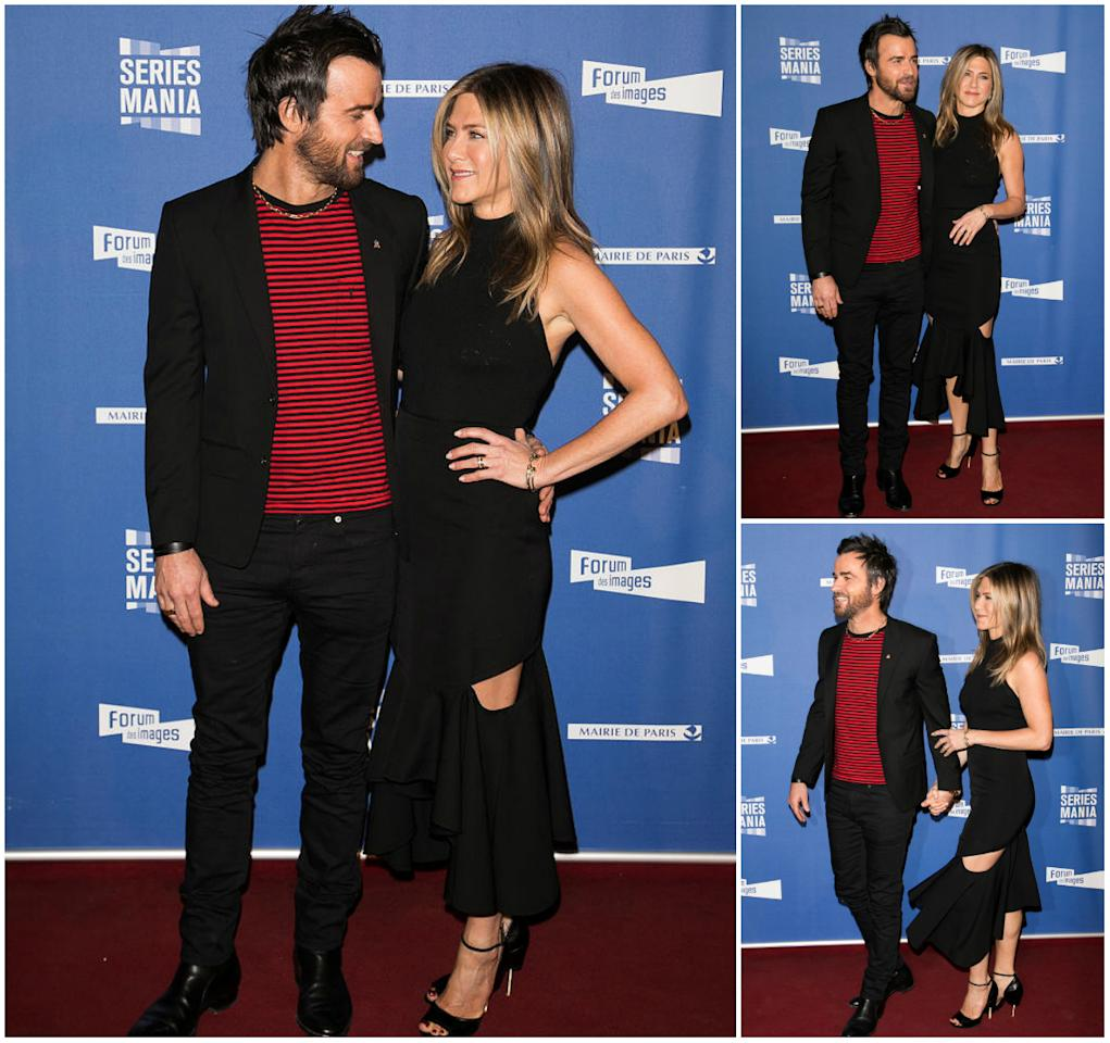 """<p><b>When: April 13, 2017 </b><br />The form-fitting, high-neck Givenchy gown turned heads as the cutouts exposed Jen's legs, rather than her back or waist (which a traditional cutout dress would reveal). The peephole dress featured a ruffled asymmetrical finish and the former """"Friends"""" star complemented the overall look with towering strappy heels. Click through the gallery to see various times Jen Aniston completely killed it in a sexy black dress! <em>(All photos: Getty) </em><br /><br /></p>"""