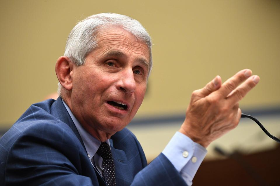 """Donald Trump lashed out at disease expert Dr Anthony Fauci and branded him a """"disaster"""" as he said Americans are """"tired"""" of hearing about Covid-19. (Photo by Kevin Dietsch-Pool/Getty Images)"""