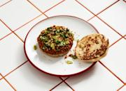 """""""This dish is our riff on Vanessa's Dumpling House sesame pancake with Szechuan beef sauce, a sandwich I've eaten so much that by now I'm likely made up of 10 percent sesame pancake,"""" Lee says. <a href=""""https://www.bonappetit.com/recipe/mushroom-sloppy?mbid=synd_yahoo_rss"""" rel=""""nofollow noopener"""" target=""""_blank"""" data-ylk=""""slk:See recipe."""" class=""""link rapid-noclick-resp"""">See recipe.</a>"""