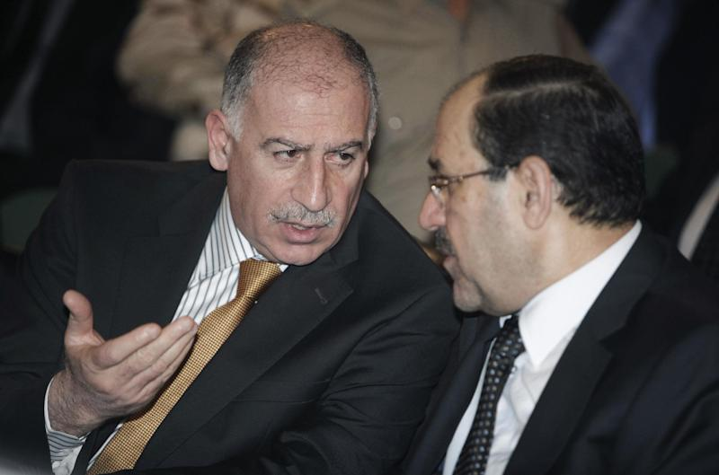 FILE - In this Thursday, Aug. 18, 2011 file photo, Iraqi's Parliament Speaker Osama al-Nujaifi, left, speaks with Iraqi's Prime Minister Nouri al- Maliki during the 30th anniversary of the founding of the Badr Organization in Baghdad, Iraq. The speaker of Iraq's parliament says the nation's prime minister must answer lawmakers' demands to unsnarl a political deadlock or face a vote to oust him from power. (AP Photo/Karim Kadim, File)