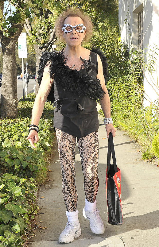 """We love fitness guru Richard Simmons' passion for terrifying fashion. We're just not quite sure a feathered blouse and fishnets make for the most appropriate and/or comfortable workout wear. Hey, at least he's not wearing his signature, skimpy red shorts. (7/19/2012)<br><br><a target=""""_blank"""" href=""""http://twitter.com/YahooOmg"""">Follow omg! on Twitter!</a>"""