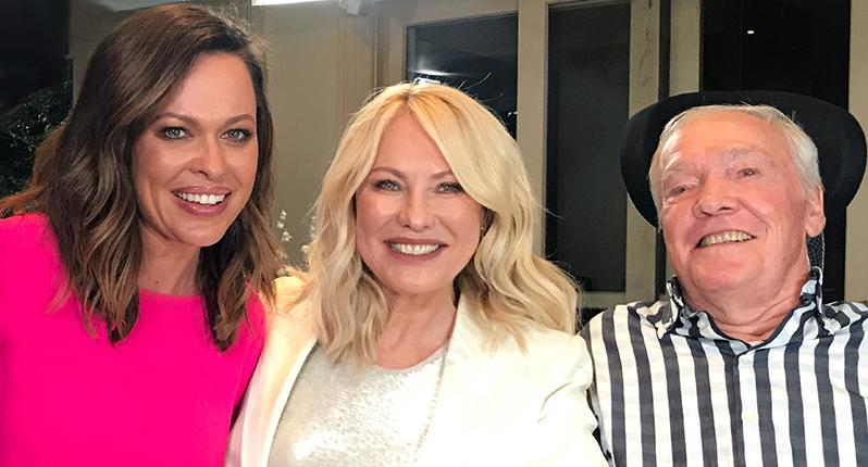Kerri-Anne Kennerley poses with reporter Angela Cox and husband John.