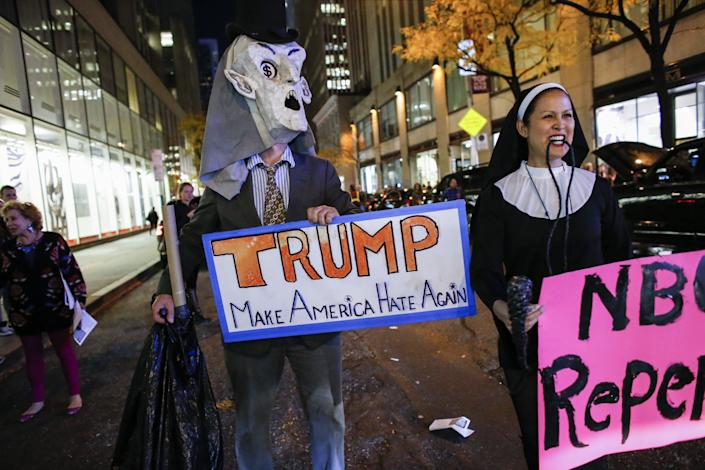 People protest in front of NBC studios while they are calling for the network to rescind the invitation to Donald Trump to host Saturday Night Live show on November 4, 2015 in New York.
