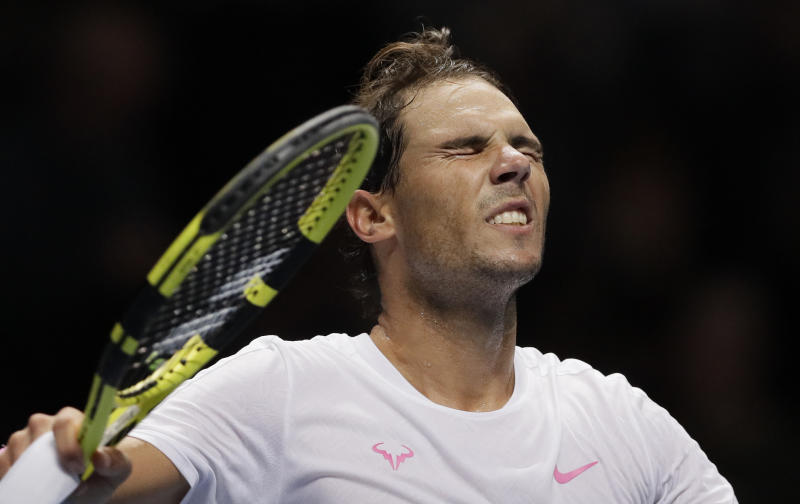 Rafael Nadal of Spain celebrates after winning match point against Daniil Medvedev of Russia during their ATP World Tour Finals singles tennis match at the O2 Arena in London, Wednesday, Nov. 13, 2019. (AP Photo/Kirsty Wigglesworth)