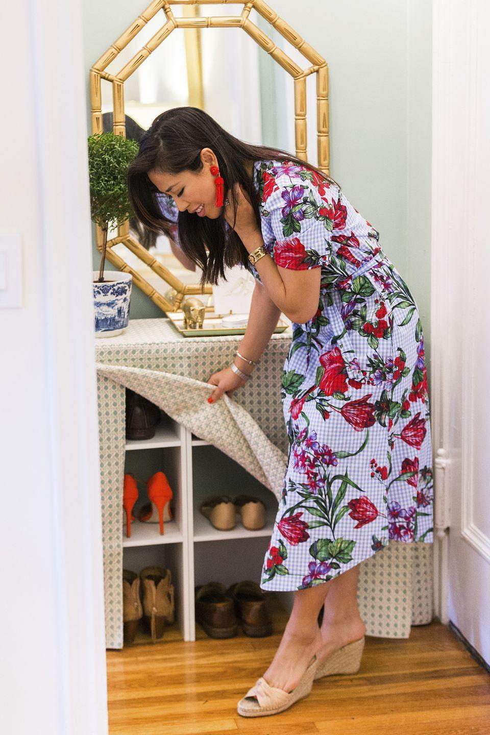 <p>Keep your entryway clutter-free by covering shoe cubbies with a fabric table skirt. Dress the top of the table with flowers, trinkets, and other decorative accents. </p>