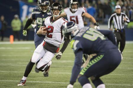 Nov 20, 2017; Seattle, WA, USA; Atlanta Falcons quarterback Matt Ryan (2) picks up a first down during the second half against the Seattle Seahawks at CenturyLink Field. The Falcons won 34-31. Troy Wayrynen-USA TODAY Sports