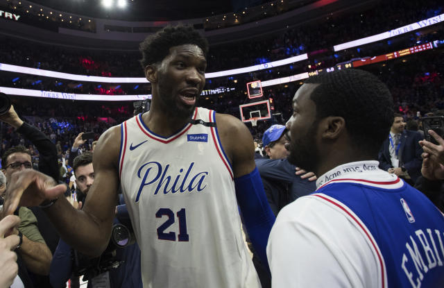<p> Philadelphia 76ers' Joel Embiid, left, of Cameroon, talks with Rapper Meek Mill, right, during the second half in Game 5 of a first-round NBA basketball playoff series against the Miami Heat, Tuesday, April 24, 2018, in Philadelphia. The 76ers won 104-91. (AP Photo/Chris Szagola) </p>