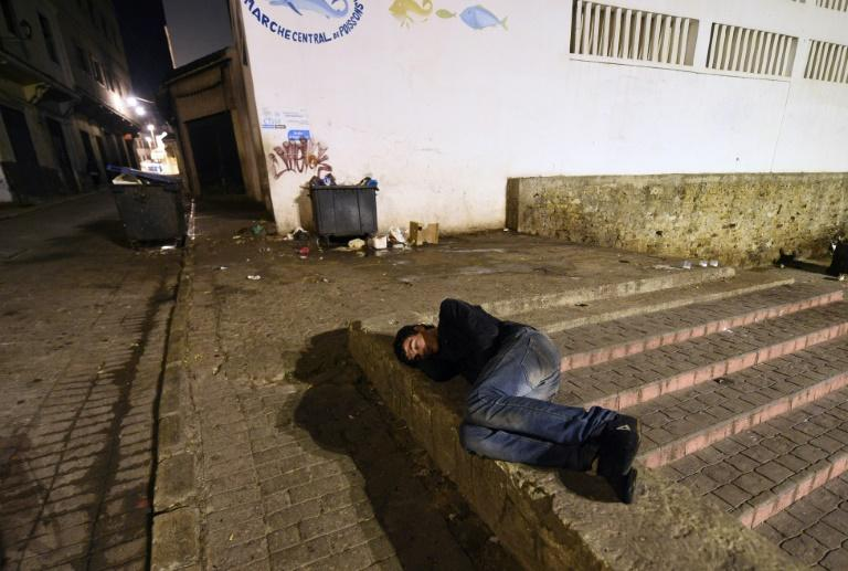 A Moroccan homeless youth sleeps in the street in the northeastern coastal city of Tangier