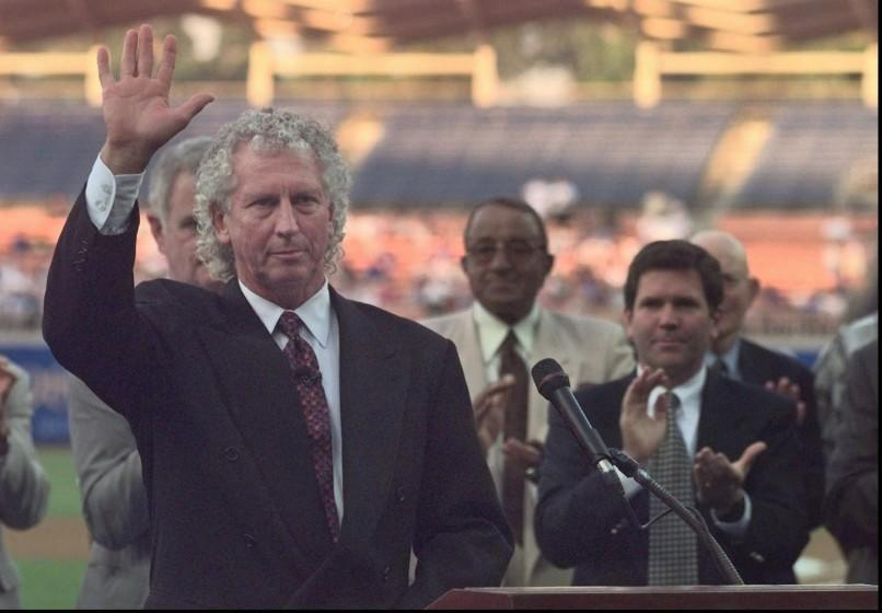 Don Sutton acknowledges applause at the conclusion of a ceremony to retire his number