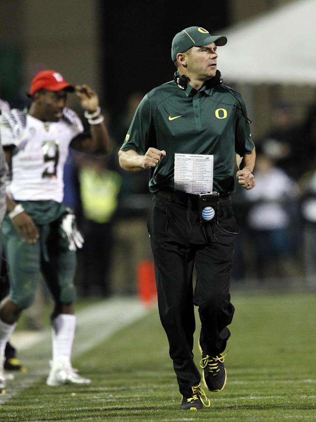 Oregon head coach Mark Helfrich runs the sideline while guiding his team against Colorado in the fourth quarter of Oregon's 57-16 victory in an NCAA college football game in Boulder, Colo., on Saturday, Oct. 5, 2013. (AP Photo/David Zalubowski)