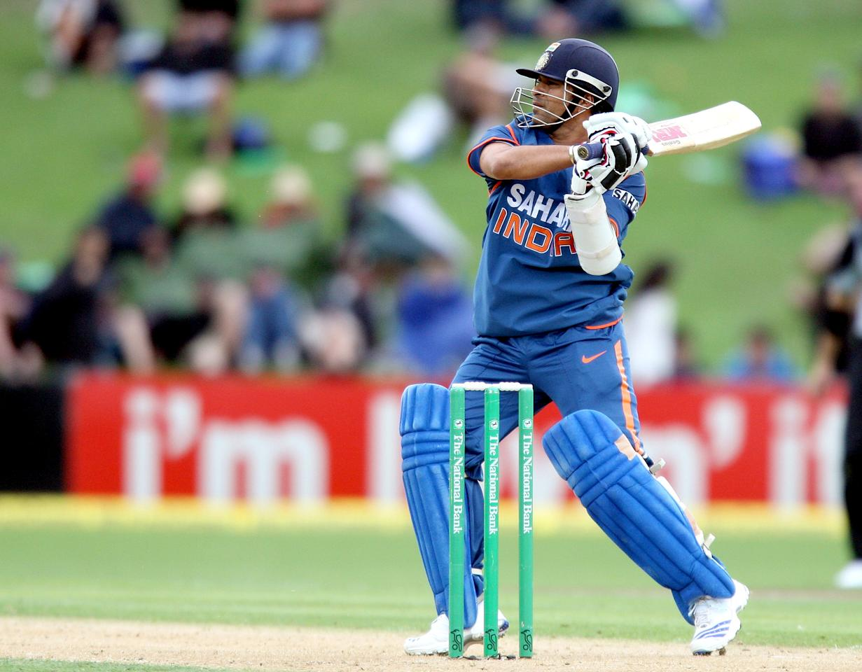 NAPIER, NEW ZEALAND - MARCH 03:  Sachin Tendulkar of India hits the ball during the first one day international match between the New Zealand Black Caps and India at McLean Park on March 3, 2009 in Napier, New Zealand.  (Photo by Marty Melville/Getty Images)