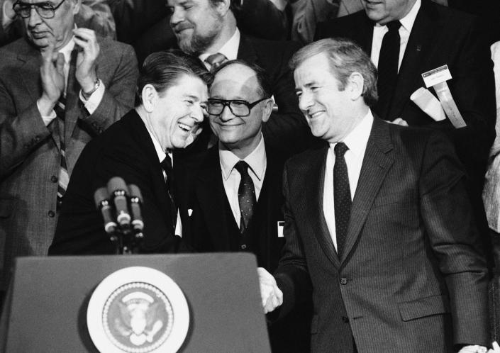 President Ronald Reagan shakes hands with Rev. Jerry Falwell Sr. after a 1984 speech to the convention of National Religious Broadcasters in Washington, D.C.