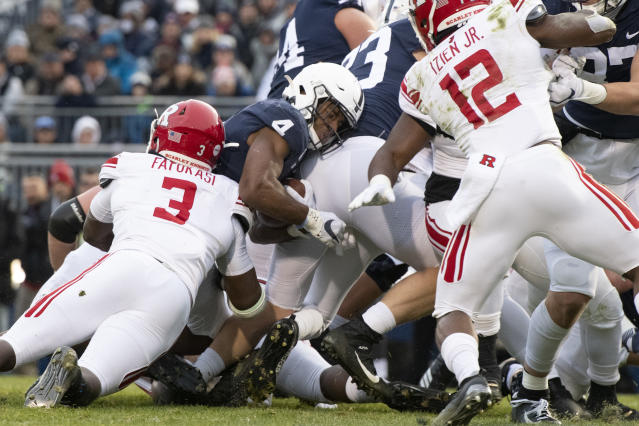 Penn State running back Journey Brown (4) fights his way into the end zone to score a first quarter touchdown against Rutgers in an NCAA college football game in State College, Pa., on Saturday, Nov. 30, 2019. (AP Photo/Barry Reeger)