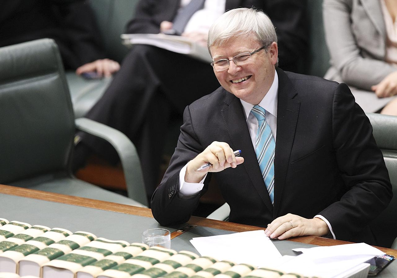 CANBERRA, AUSTRALIA - JUNE 27: Prime Minister Kevin Rudd laughs at a joke by Defence Minister Stephen Smith while he announces he will not contest his seat in the upcoming election in the House of Representatives on June 27, 2013 in Canberra, Australia. Kevin Rudd won an Australian Labor Party leadership ballot 57-45 last night, and will be sworn in this morning as Australian Prime Minister by Governor-General Quentin Bryce. Rudd was Prime Minister from 2007 to 2010 before he was dumped by his party for his deputy Julia Gillard. Gillard has announced that she will leave parliament and not contest her seat following her ballot loss. (Photo by Stefan Postles/Getty Images)