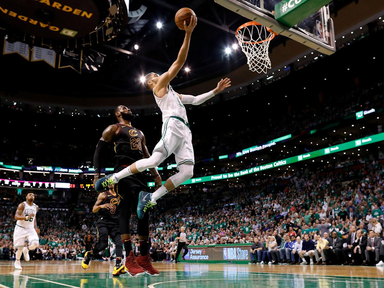 May 23, 2018; Boston, MA, USA; Boston Celtics forward Jayson Tatum (0) attempts a layup in front of Cleveland Cavaliers forward LeBron James (23) during the third quarter of game five of the Eastern conference finals of the 2018 NBA Playoffs at TD Garden. Mandatory Credit: Greg M. Cooper-USA TODAY Sports     TPX IMAGES OF THE DAY