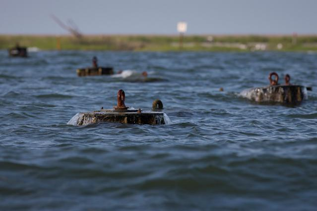 """<p>Wave breakers are seen along the """"Uppards,"""" part of Tangier Island, Virginia, Aug. 2, 2017. (Photo: Adrees Latif/Reuters) </p>"""