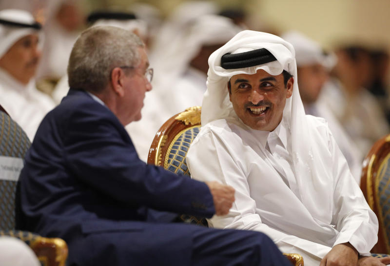 Emir of Qatar Sheikh Tamim bin Hamad Al Thani speaks to IOC President Thomas Bach ahead of the opening ceremony for the World Athletics Championships on the Corniche in Doha, Qatar, Friday, Sept. 27, 2019. (AP Photo/Hassan Ammar)
